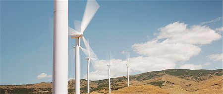 Wind turbines spinning in rural landscape Stock Photo - Premium Royalty-Free, Code: 6113-07160900