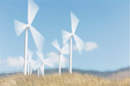 Wind turbines spinning in rural landscape Stock Photo - Premium Royalty-Free, Code: 6113-07160909