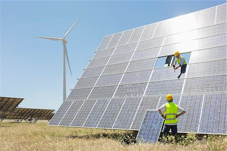 Workers examining solar panel in rural landscape Stock Photo - Premium Royalty-Free, Code: 6113-07160920