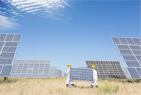 solar power - Scientists carrying solar panel in rural landscape Stock Photo - Premium Royalty-Free, Code: 6113-07160937