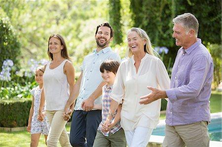 Multi-generation family walking in backyard Stock Photo - Premium Royalty-Free, Code: 6113-07241967