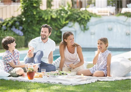 Family enjoying picnic in grass Stock Photo - Premium Royalty-Free, Code: 6113-07242067