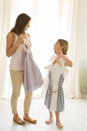 dress - Mother and daughter picking out clothes in bedroom Stock Photo - Premium Royalty-Free, Code: 6113-07242094