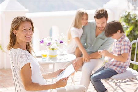 Family relaxing on patio Stock Photo - Premium Royalty-Free, Code: 6113-07242096
