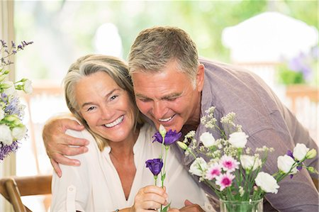 smelling - Senior couple smelling flowers Stock Photo - Premium Royalty-Free, Code: 6113-07242011