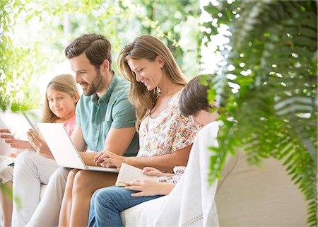 Family reading and using technology on patio Stock Photo - Premium Royalty-Free, Code: 6113-07242020