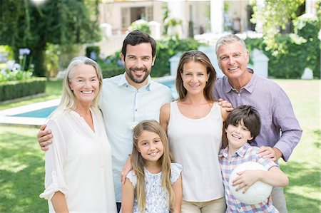 Multi-generation family smiling in backyard Stock Photo - Premium Royalty-Free, Code: 6113-07242026