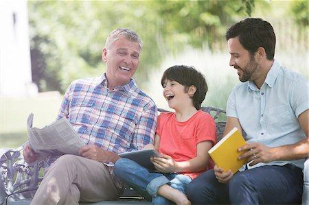 preteens pictures older men - Multi-generation men laughing on bench Stock Photo - Premium Royalty-Free, Code: 6113-07242028