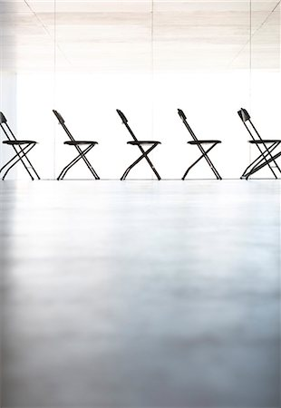 five - Chairs lined up in a row in office Stock Photo - Premium Royalty-Free, Code: 6113-07242175