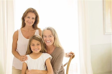 Multi-generation women smiling at window Stock Photo - Premium Royalty-Free, Code: 6113-07242104