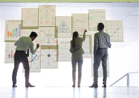 strategy - Business people working with charts and graphs on glass wall Stock Photo - Premium Royalty-Free, Code: 6113-07242128