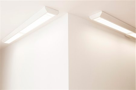 Ceiling lights in corner of office Stock Photo - Premium Royalty-Free, Code: 6113-07242245