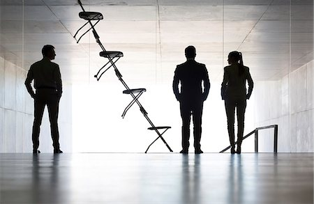 Business people standing next to office chair installation art Stock Photo - Premium Royalty-Free, Code: 6113-07242226