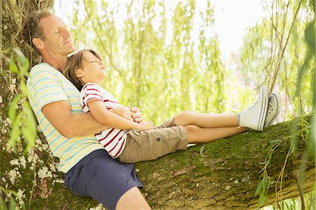 Father and son relaxing in tree Stock Photo - Premium Royalty-Free, Code: 6113-07242344