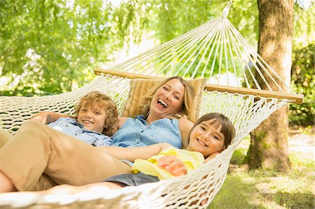 Mother and children relaxing in hammock Stock Photo - Premium Royalty-Free, Code: 6113-07242350
