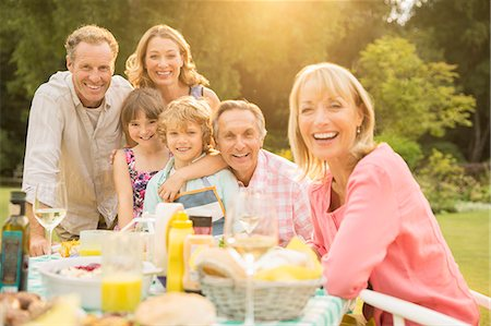 Multi-generation family at table in backyard Stock Photo - Premium Royalty-Free, Code: 6113-07242367