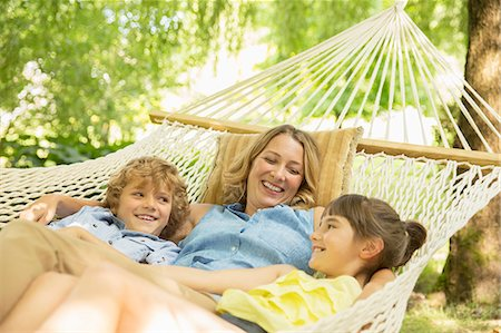 Mother and children relaxing together in hammock Stock Photo - Premium Royalty-Free, Code: 6113-07242365