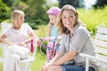 Woman smiling in backyard Stock Photo - Premium Royalty-Free, Code: 6113-07242371