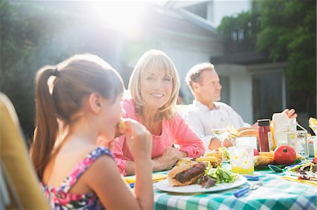 Family eating lunch at patio table Stock Photo - Premium Royalty-Free, Code: 6113-07242385