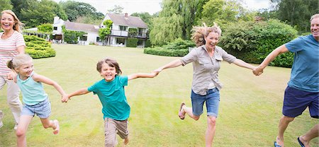 family  fun  outside - Multi-generation family holding hands and running in backyard Stock Photo - Premium Royalty-Free, Code: 6113-07242300
