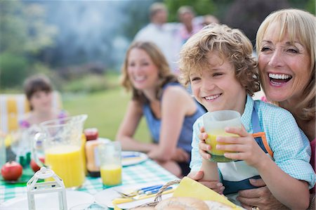Family eating together outdoors Stock Photo - Premium Royalty-Free, Code: 6113-07242307