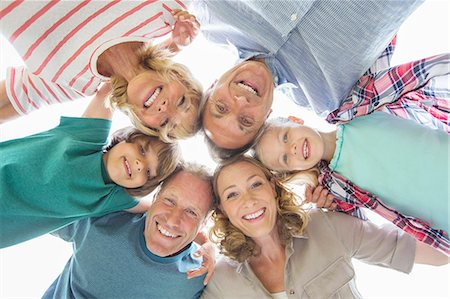 Family smiling together outdoors Stock Photo - Premium Royalty-Free, Code: 6113-07242326