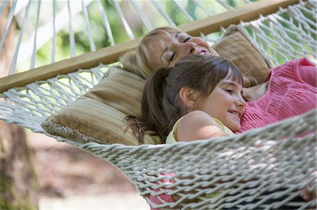 summer - Woman and granddaughter relaxing in hammock Stock Photo - Premium Royalty-Free, Code: 6113-07242463