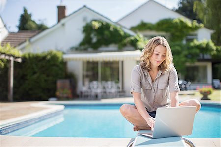 domestic life - Woman using laptop on diving board at poolside Stock Photo - Premium Royalty-Free, Code: 6113-07242480