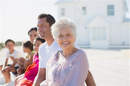 Multi-generation family smiling outside beach house Stock Photo - Premium Royalty-Free, Code: 6113-07242490