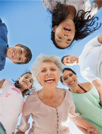 Multi-generation family smiling in huddle Stock Photo - Premium Royalty-Free, Code: 6113-07242492