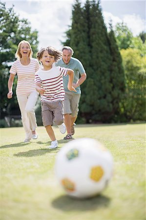 Grandparents and grandson playing soccer Stock Photo - Premium Royalty-Free, Code: 6113-07242439