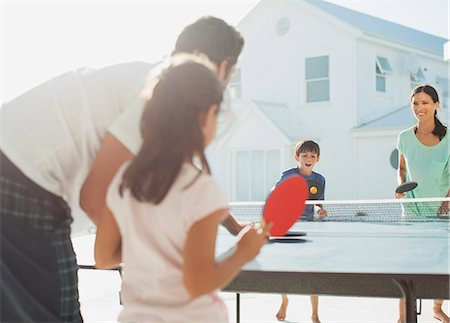 preteen girl - Family playing table tennis outside house Stock Photo - Premium Royalty-Free, Code: 6113-07242552
