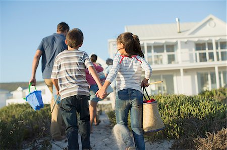 Brother and sister holding hands on beach path Stock Photo - Premium Royalty-Free, Code: 6113-07242574
