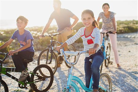 preteen beach - Family riding bicycles on sunny beach Stock Photo - Premium Royalty-Free, Code: 6113-07242579