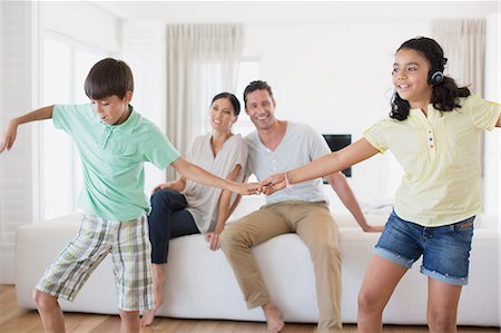 preteen dancing - Parents watching daughter and son dancing in living room Stock Photo - Premium Royalty-Free, Code: 6113-07242589