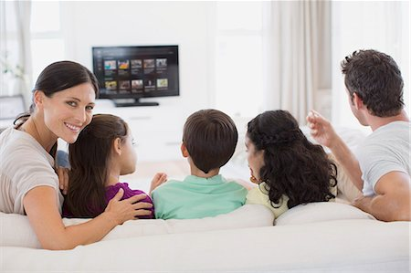 Family watching TV in living room Stock Photo - Premium Royalty-Free, Code: 6113-07242592