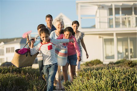 preteen family - Family walking on beach path outside house Stock Photo - Premium Royalty-Free, Code: 6113-07242500