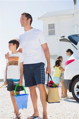 preteen beach - Father and son holding beach gear by car Stock Photo - Premium Royalty-Free, Code: 6113-07242502