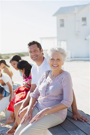 Multi-generation family smiling outside beach house Stock Photo - Premium Royalty-Free, Code: 6113-07242512