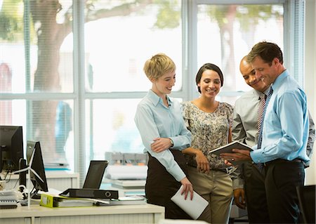 four - Business people with digital tablet talking in office Stock Photo - Premium Royalty-Free, Code: 6113-07242679
