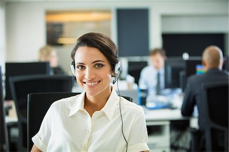 sale - Businesswoman wearing headset in office Stock Photo - Premium Royalty-Free, Code: 6113-07242693