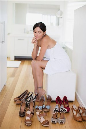 decision - Woman choosing shoes in bedroom Stock Photo - Premium Royalty-Free, Code: 6113-07242601