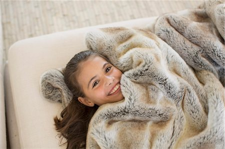 fur - Girl relaxing under fur blanket Stock Photo - Premium Royalty-Free, Code: 6113-07242602