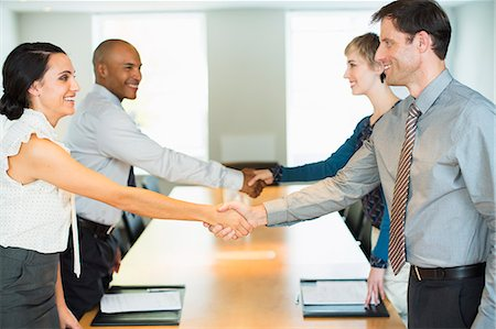 Business people shaking hands in meeting Stock Photo - Premium Royalty-Free, Code: 6113-07242731
