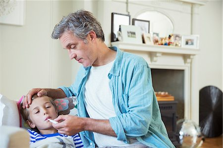 Father checking son's temperature Stock Photo - Premium Royalty-Free, Code: 6113-07242863