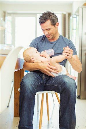 Father feeding baby in kitchen Stock Photo - Premium Royalty-Free, Code: 6113-07242883