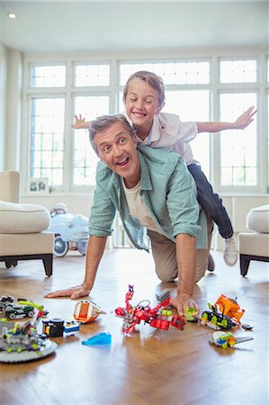 Father and son playing together Stock Photo - Premium Royalty-Free, Code: 6113-07242820
