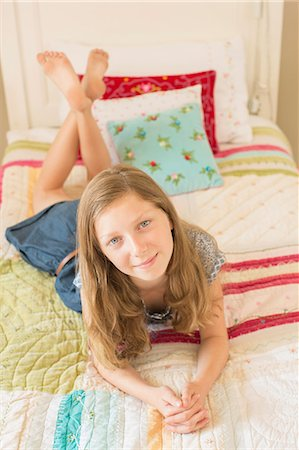 Girl laying on bed Stock Photo - Premium Royalty-Free, Code: 6113-07242833