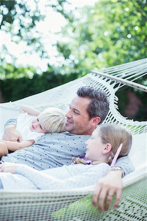 sister - Father and children relaxing in hammock Stock Photo - Premium Royalty-Free, Code: 6113-07242943