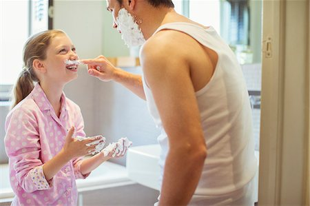 Father and daughter playing with shaving cream Stock Photo - Premium Royalty-Free, Code: 6113-07242947